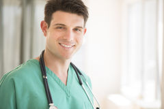 Doctor With Stethoscope Around Neck Smiling In Hospital Royalty Free Stock Image