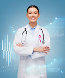 Doctor with stethoscope, cancer awareness ribbon Royalty Free Stock Image