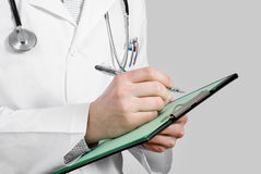 Doctor with stethoscope and clipboard Royalty Free Stock Photo