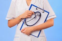 Doctor with stethoscope and clipboard Royalty Free Stock Image