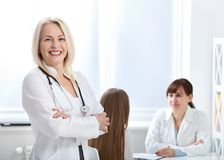 Doctor with stethoscope. Healthcare and medical concept - doctor with patient in hospital Royalty Free Stock Images