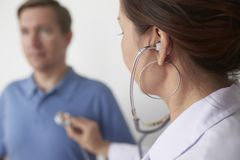 Doctor with stethoscope royalty free stock photography