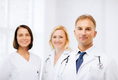 Doctor with stethoscope and colleagues Stock Image