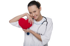 Doctor with stethoscope covers heart Stock Image