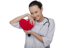 Doctor with stethoscope covers heart Royalty Free Stock Photo