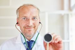 Doctor with stethoscope. For diagnose and examination stock photo
