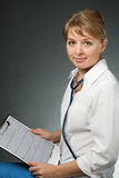 Doctor with stethoscope and electrocardiogram Royalty Free Stock Photos