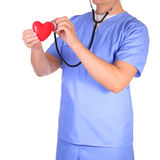 Doctor with stethoscope examining red heart, isolated Royalty Free Stock Images
