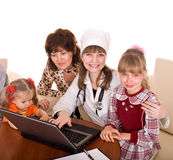 Doctor with stethoscope and family. Stock Photo