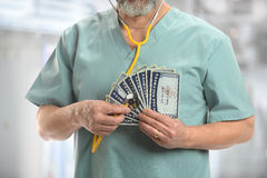 Doctor with Stethoscope on Generic Social Security Cards Royalty Free Stock Image