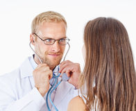 Doctor with Stethoscope and Glasses Examining Patient Stock Image