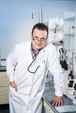Doctor with stethoscope, glasses and robe Royalty Free Stock Photography