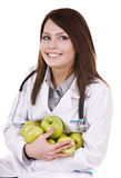 Doctor with stethoscope and group green apples. Stock Photos