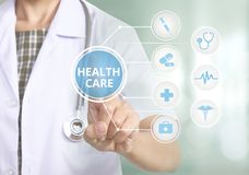 Doctor with stethoscope hand press the button health care icon. stock images