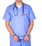 Doctor with stethoscope in handcuffs isolated Royalty Free Stock Photos