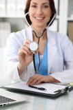 Doctor with a stethoscope in the hands, close up. Physician ready to examine and help patient. Medicine, healthcare and Stock Image