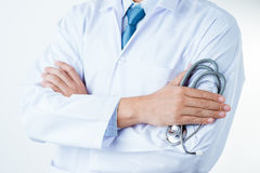 Doctor with a stethoscope. In the hands on whotw back ground stock photo