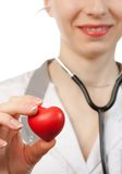 Doctor with stethoscope and heart Stock Photo