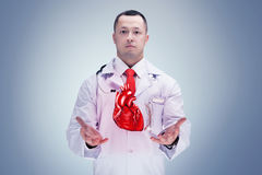 Doctor with stethoscope and heart on the hands in a hospital. High resolution. stock photo