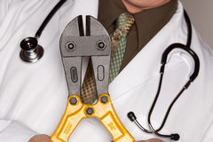 Doctor with Stethoscope Holding A Cable Cutters Royalty Free Stock Photo