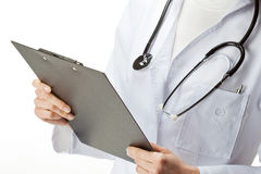 Doctor with stethoscope holding a clipboard Stock Photos