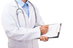 Doctor with a stethoscope and holding a clipboard. Royalty Free Stock Images