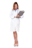 Doctor with a stethoscope and holding a clipboard. Royalty Free Stock Photo