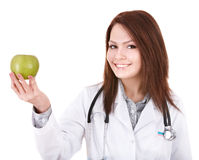 Doctor with stethoscope holding green apple.. Royalty Free Stock Image