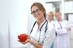 Doctor with stethoscope holding heart, isolated on Royalty Free Stock Images