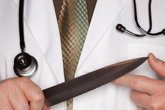 Doctor with Stethoscope Holding A Large Knife Royalty Free Stock Photos