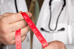 Doctor with Stethoscope Holding Measuring Tape Royalty Free Stock Photo