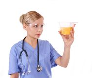 Doctor with stethoscope holding urine sample Royalty Free Stock Images