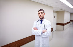Doctor with stethoscope at hospital corridor Royalty Free Stock Images