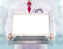Doctor with stethoscope and laptop in a hospital Royalty Free Stock Images