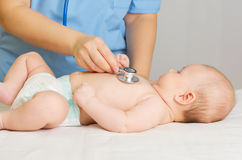 Doctor with stethoscope listen baby Royalty Free Stock Photography