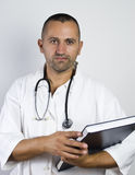 Doctor with stethoscope looking up. Close up Stock Image