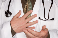 Doctor with Stethoscope Making Hand Gestures Stock Photo