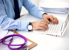 Doctor with stethoscope on the patient's admission Stock Photos