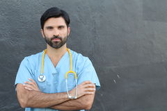 Doctor with stethoscope portrait isolated with arms crossed Stock Photos