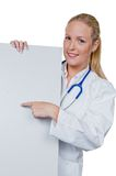 Doctor with stethoscope and shield Stock Photography