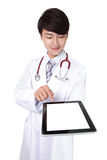 Doctor with stethoscope showing blank tablet pc Stock Image