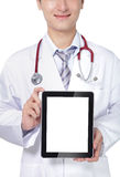 Doctor with stethoscope showing blank tablet pc Royalty Free Stock Photo