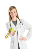 Doctor With Stethoscope Showing Green Apple And Tape Measure Stock Photography