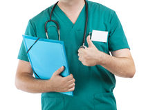 Doctor with stethoscope showing thumb up Stock Photos