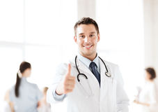 Doctor with stethoscope showing thumbs up. Healthcare and medical concept - doctor with stethoscope showing thumbs up Stock Photography
