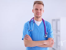 Doctor with stethoscope standing , crossed arms Royalty Free Stock Photography