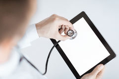 Doctor with stethoscope and tablet pc Royalty Free Stock Photography
