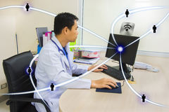 Doctor and stethoscope use computor Royalty Free Stock Images