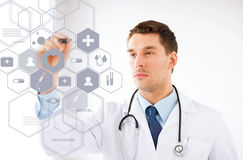 Doctor with stethoscope and virtual screen. Healthcare, medical and future technology concept - male doctor with stethoscope and virtual screen Royalty Free Stock Photos