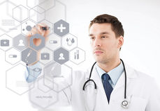 Doctor with stethoscope and virtual screen. Healthcare, medical and future technology concept - male doctor with stethoscope and virtual screen Stock Image